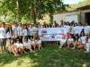 Цялата група позира с тениските и плаката на проекта./ The whole group posing with the T-shirts and the poster of the project.